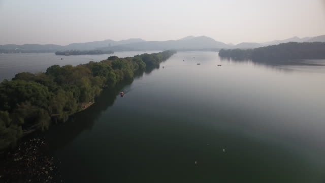 west lake from drone point of view, china - hangzhou stock videos & royalty-free footage
