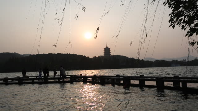 West lake is a famous travel destination in Hangzhou and a world cultural heritage site