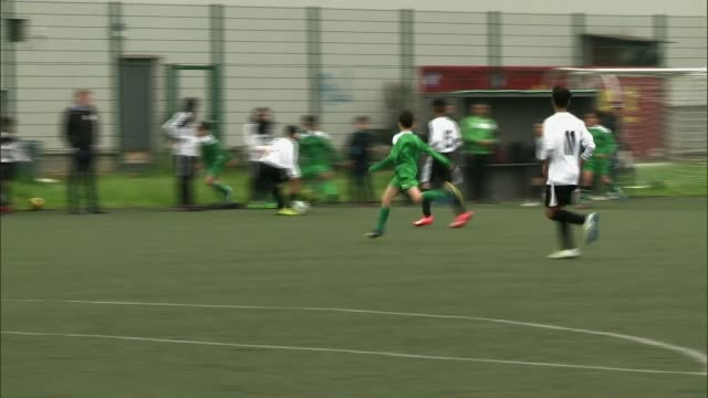 west london football club which helps tackle youth radicalisation visits brussels; belgium: brussels: ext boys playing football girls playing... - youth club stock videos & royalty-free footage