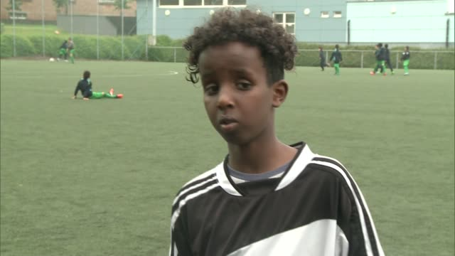 west london football club which helps tackle youth radicalisation visits brussels; belgium: brussels: ext blurred shot of children along with goal... - darstellen stock-videos und b-roll-filmmaterial