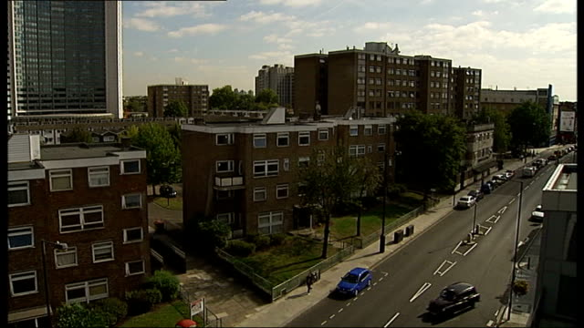 west london fulham ext general views west kensington estate 1970s blocks of flats playground reporter to camera charlie treloggan interview sot east... - kensington and chelsea stock videos & royalty-free footage