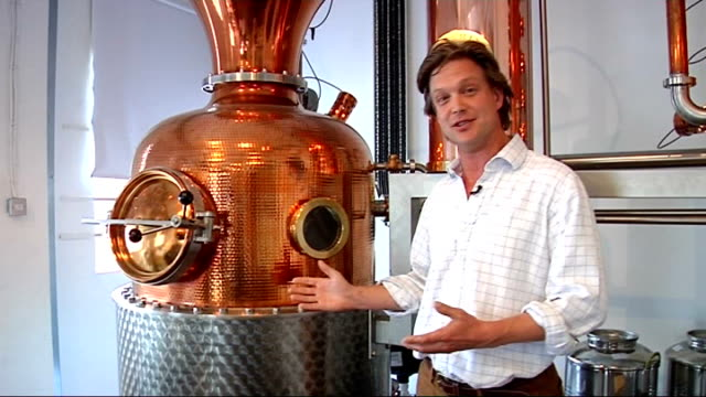 west london hammersmith ext quiet terraced residential street reporter along into building various of small batch copper still distillery in... - distillery still stock videos & royalty-free footage