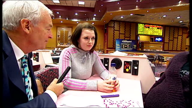 vídeos y material grabado en eventos de stock de west midlands birmingham int various general views bingo hall reporter speaking with various people in bingo hall and asking which party they will... - bingo
