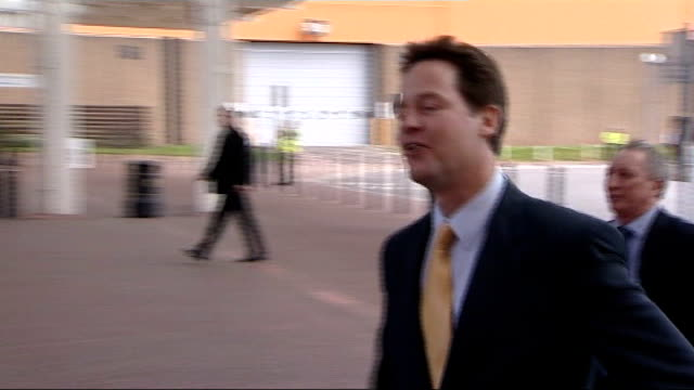 west midlands: birmingham: the nec: ext ** flash photography ** nick clegg mp arriving at venue for liberal democrat party conference [applause heard... - politics and government stock videos & royalty-free footage