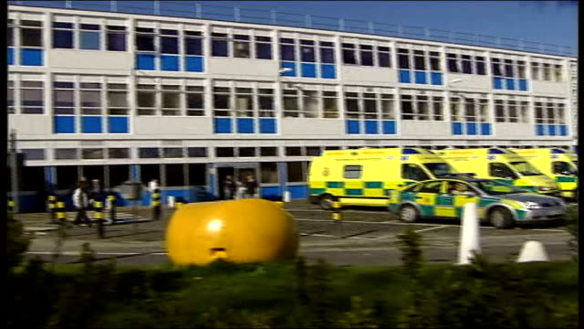 west midlands sandwell and west birmingham hospital ext west midlands ambulance fast along road pan to bv ambulance along outside hospital entrance... - west midlands stock videos and b-roll footage