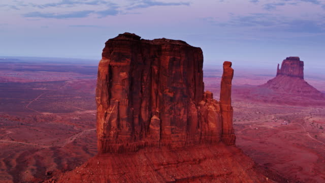 west mitten butte at sunset, monument valley - drone shot - navajo reservation stock videos and b-roll footage