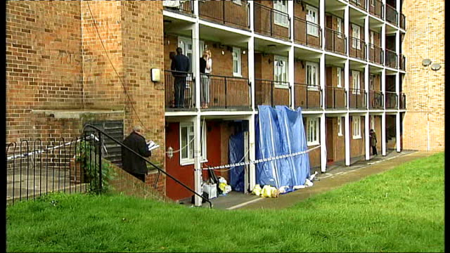 Men found dead in flat Man charged ENGLAND London South Norwood EXT Flat where two men were found stabbed to death curtained off with tarpaulin...