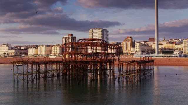 west pier ruins and brighton seafront - drone shot - 1975 stock videos & royalty-free footage
