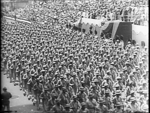 West Point Army men march in New York War Parade for Flag Day and MacArthur Day and a wartime celebration