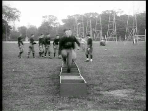 vidéos et rushes de west point football players running thru boxes on ground in practice / newsreel - 1920 1929
