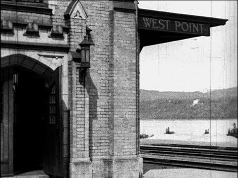 stockvideo's en b-roll-footage met b/w 1920 west point, ny train station / hudson river in background / documentary - west point new york