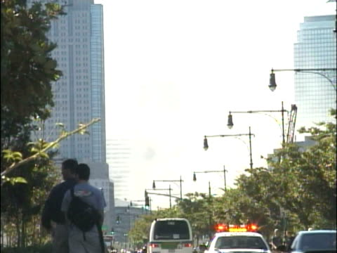 west side highway area after both towers have collapsed emergency vehicles rushing to scene people on cell phones people watching smoke rising from... - september 11 2001 attacks stock videos & royalty-free footage