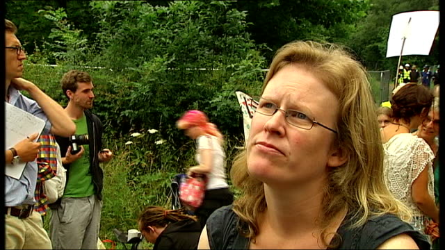 west sussex fracking site blocked by protesters; louisa delpy interview sot four workers looking on workers along behind fence with 'no access' sign... - sports training drill stock videos & royalty-free footage