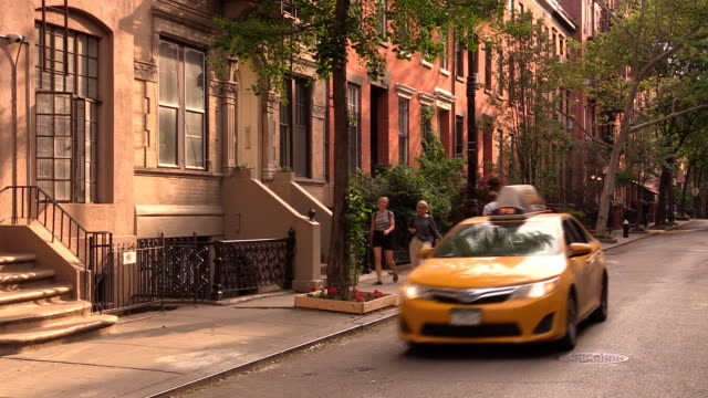west village street in new york city - gelbes taxi stock-videos und b-roll-filmmaterial