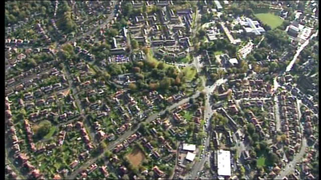 air views of countryside, clouds, housing, construction work, inner city buildings, factories; leeds: ext air views of residential area showing rows... - leeds stock videos & royalty-free footage