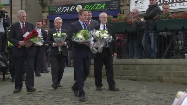 west yorkshire birstall ext statue of 18thcentury english theologian and scientist joseph priestley in town centre pan down to flowers floral... - jo cox politician stock videos and b-roll footage