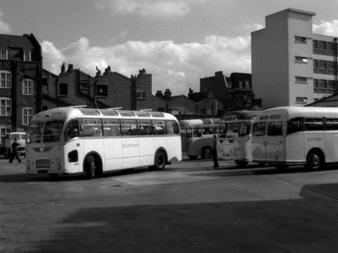 a west yorkshire coach pulls out from a coach station 1961 - west yorkshire stock-videos und b-roll-filmmaterial