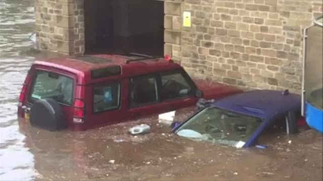 Rescue workers save man trapped in his car Sowerby Bridge Partially submerged cars