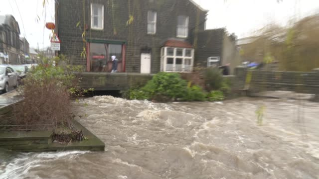 rescue workers save man trapped in his car west yorkshire flooded river - ウェストヨークシャー点の映像素材/bロール