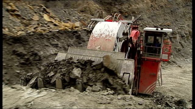 west yorkshire: sharlston mine: ext digger removing coal at surface mine reporter to camera - absence stock videos & royalty-free footage