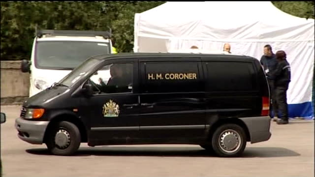West Yorkshire Shipley EXT Black coroner's van reversing near to River Aire