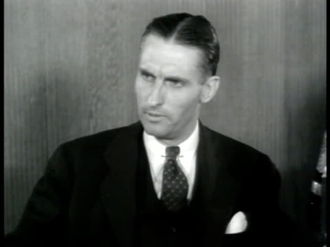 vídeos de stock, filmes e b-roll de westbrook van voorhis asking hansen w baldwin about importance of bombing ms baldwin saying sot round the clock bombing will be major factor in... - 1943