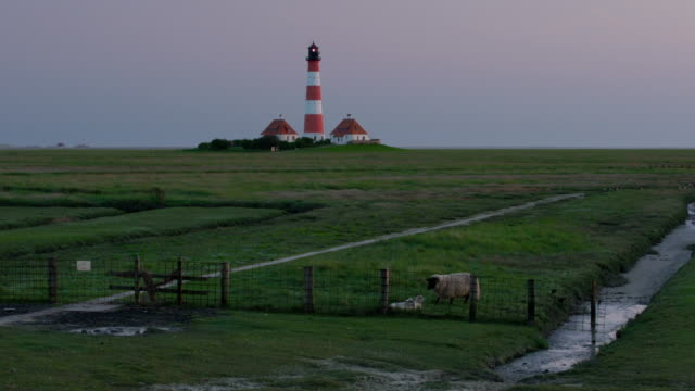 westerhever lighthouse at dusk - schleswig holstein stock videos & royalty-free footage