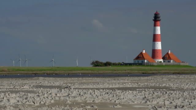 westerhever lighthouse - schleswig holstein stock videos & royalty-free footage