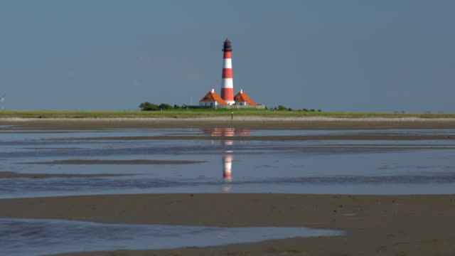 zi westerhever lighthouse - schleswig holstein stock videos & royalty-free footage