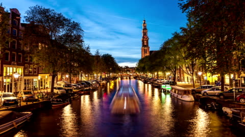 westerkerk with canal in amsterdam - canal stock videos & royalty-free footage