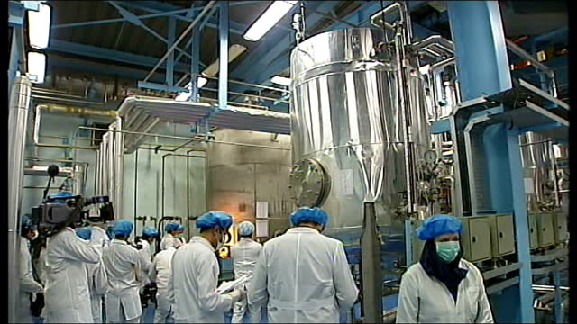 western concern as president insists nuclear programme will continue; tx 5.2.2007 isfahan: int workers and people inside uranium conversion plant... - uranium stock videos & royalty-free footage