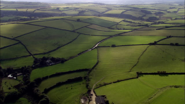 western edge of exmoor  - aerial view - england, devon, north devon district, united kingdom - grass area stock videos and b-roll footage