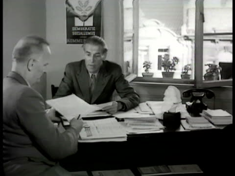Western Germany Communist Poster 'Einheit' 'Demokratie Sozialsmus' MS Communist boss of Western Germany Max Reimann at desk talking w/ another man