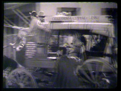 western gold rush town tracking stage coach passing by on road moving out of town ghost town angled ws abandoned small town buildings tu open porch... - california gold rush stock videos and b-roll footage