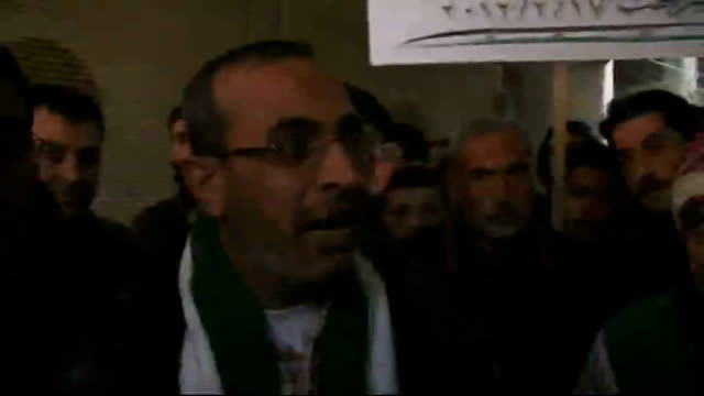 western leaders say revolution must come from within syria; syria: saraqib: int three men at anti-government rally pull out to gv cbv man chanting... - poet stock videos & royalty-free footage