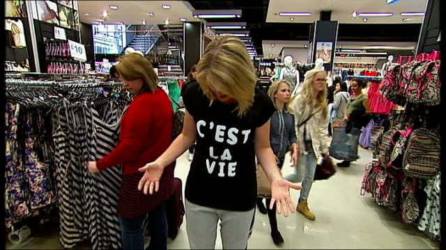 western retailers campaign for bangladesh factory safety plan; london: various shots tightly edited sequence in primark shop speeded up sequence... - etikett stock-videos und b-roll-filmmaterial
