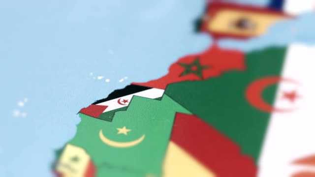 western sahara borders with national flag on world map - north africa stock videos & royalty-free footage