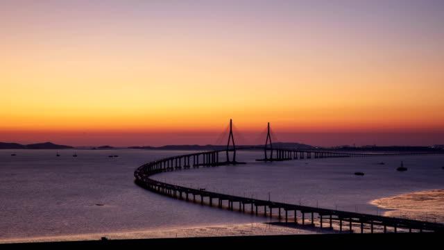 western sea sunset scenery with incheon bridge / incheon, south korea - bogen architektonisches detail stock-videos und b-roll-filmmaterial