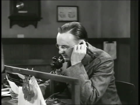 western union telegraph office male using candlestick telephone reading telegram to recipient 'three more ships torpedoedpresident moves up special... - telekommunikationsgerät stock-videos und b-roll-filmmaterial
