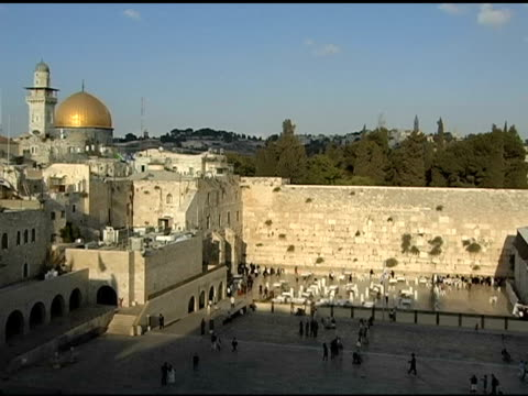 western wall with dome of the rock in distance - torah stock videos and b-roll footage