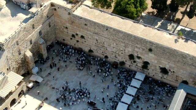 western wall, with thousands of jewish prayers/ aerial vertical view, old city of jerusalem - praying stock videos & royalty-free footage