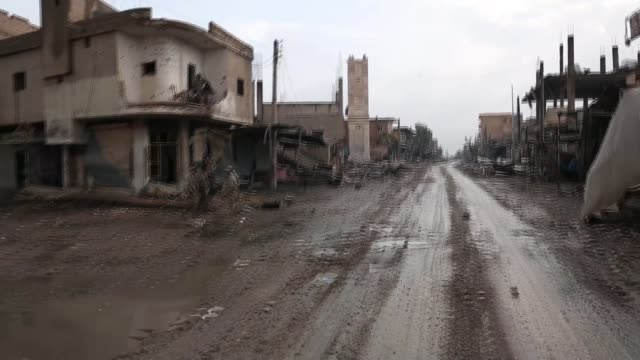 westernbacked militia in 'final battle' with islamic state syria shot rubble and destroyed buildings alongside dirt road tracking shot soldiers on... - syria stock videos & royalty-free footage