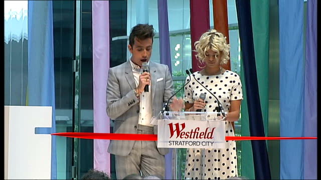 westfield stratford city shopping centre opens int gv shoppers about in shopping complex shoppers gathered behind barriers for opening ceremony nick... - big mac stock videos and b-roll footage