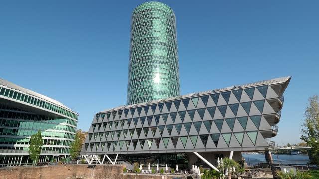 westhafen tower in frankfurt, germany - tower stock-videos und b-roll-filmmaterial