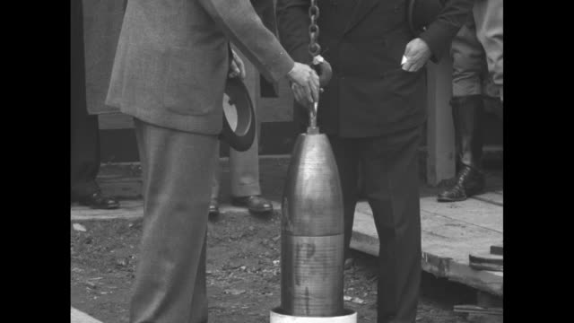 vs westinghouse chairman of the board a w robertson and new york world's fair president grover whalen help guide time capsule as it is lowered into... - world's fair stock videos and b-roll footage