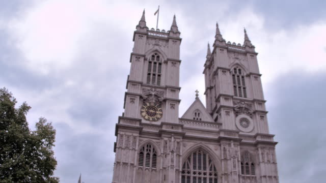 Westminster Abbey church against cloudy sky in London, England.