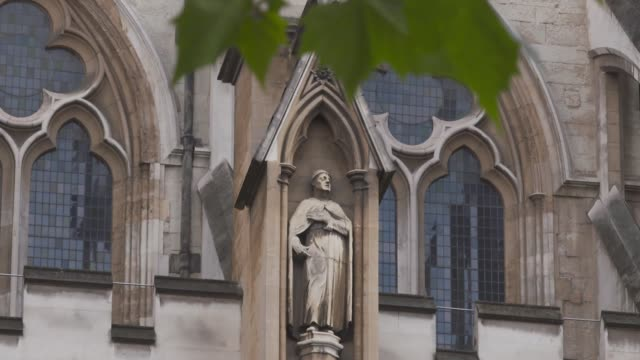 london westminster ext gvs westminster abbey / sign 'welcome to westminster abbey' / stonework statues friezes and windows on the walls of the abbey - stone object stock videos & royalty-free footage