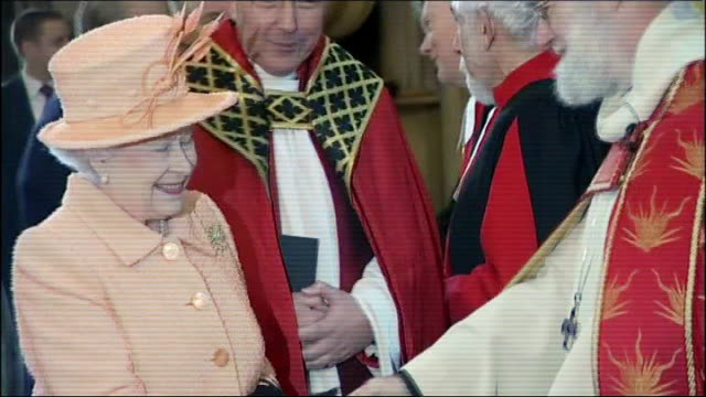 Queen Elizabeth II shakes hands with Dr Rowan Williams and Dr John Sentamu as she arrives for a short service to open the General Synod * * FLASH