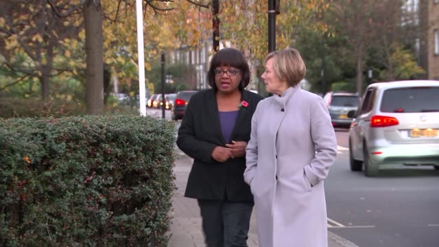 theresa may orders investigation and calls for new grievance procedure for complaints london ext diane abbott mp along street with reporter - diane abbott stock videos & royalty-free footage