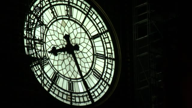 further allegations emerge big ben clockface lit up at night westminster palace windows low angle shot street lamp with victoria tower behind - victoria tower stock-videos und b-roll-filmmaterial